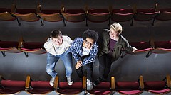 "This summer, Lawrence High students Liam Romano, left, Jalyn Banks and Julian Weslander traveled to Oskarshamn, Sweden, where they helped write a musical called ""Everglow."" It tells the story of post-WWI watch painters who suffered radiation poisoning in a New Jersey factory. The three are pictured on Wednesday at the school."