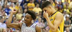 Kansas guard Devonte' Graham (4) pumps his fist in the closing seconds of the game during the Showdown for Relief exhibition, Sunday, Oct. 22, 2017 at Sprint Center in Kansas City, Missouri. At right is Missouri forward Michael Porter Jr. (13).