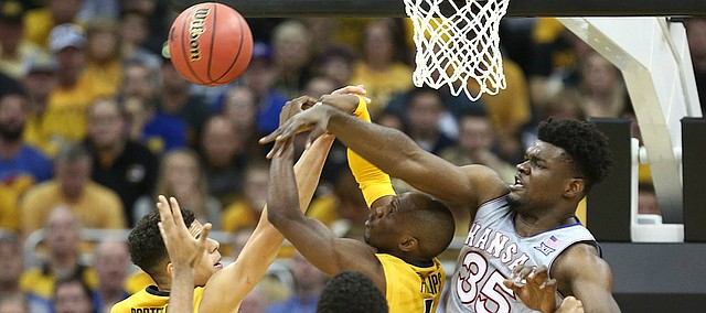 Kansas center Udoka Azubuike (35) swats away a ball from several Missouri players during the second half of the Showdown for Relief exhibition, Sunday, Oct. 22, 2017 at Sprint Center in Kansas City, Missouri.