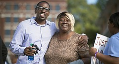 In this Oct. 13, 2017, file photo, Lamonte McIntyre, who was imprisoned for 23 years for a 1994 double murder in Kansas that he always said he didn't commit, walks out of a courthouse in Kansas City, Kan., with his mother, Rosie McIntyre, after the district attorney dropped the charges. (Tammy Ljungblad /The Kansas City Star via AP, File)