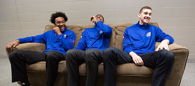 Kansas guards Devonte' Graham, left, Malik Newman and Sviatoslav Mykhailiuk can't contain themselves as they sit for a group interview during Big 12 Media Day, Tuesday, Oct. 24, 2017 at Sprint Center in Kansas City, Mo.