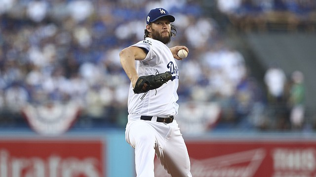 Los Angeles Dodgers starting pitcher Clayton Kershaw throws during the first inning of Game 1 of baseball's World Series against the Houston Astros Tuesday in Los Angeles.