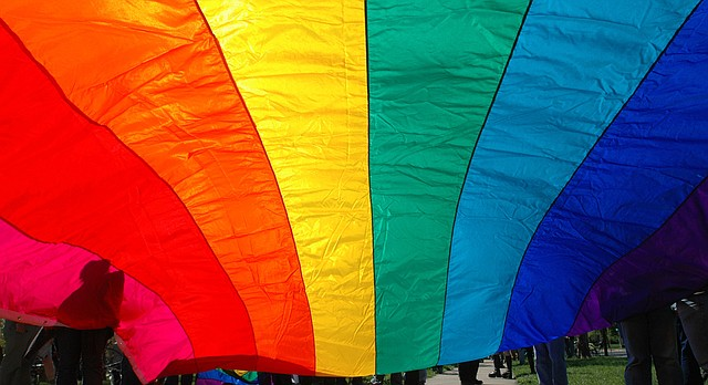 A gay pride flag whips in the wind as marchers prepare for a march down Massachusetts Street in this file photo from April 23, 2005.