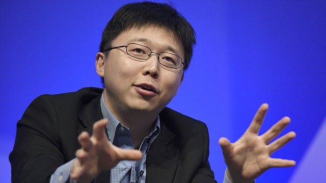 In this Dec. 1, 2015 file photo, Feng Zhang of the Broad Institute of MIT participates in a panel discussion at the National Academy of Sciences international summit on the safety and ethics of human gene editing, in Washington. Scientists are altering a powerful gene-editing technology in hopes of one day fighting diseases without making permanent changes to people's DNA. (AP Photo/Susan Walsh)