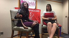 "Antonia Okafor (left), a prominent gun rights activist and National Rifle Association spokeswoman, takes questions from moderator Victoria Snitsar (right), during an event Wednesday at the University of Kansas. The event, sponsored by KU's College Republicans and the Network of enlightened Women, discussed campus carry, conservative feminism and Okafor's role as ""the face"" of modern gun rights advocacy."