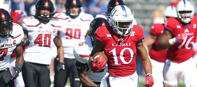 Kansas running back Khalil Herbert (10) charges up the field to set up a touchdown for the Jayhawks during the third quarter on Saturday, Oct. 7, 2017 at Memorial Stadium.