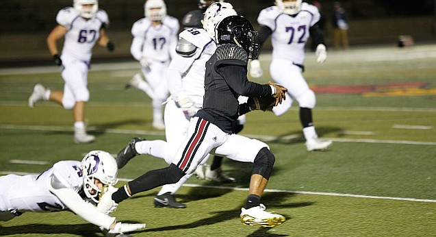 Lawrence High quarterback Dante Jackson (1) runs down the field with the ball during the football game against Blue Valley Northwest on Oct. 27, 2017. Lawrence won 28-27.
