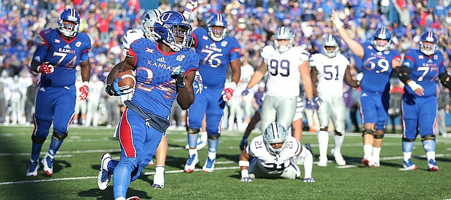 Kansas running back Taylor Martin (24) runs in a touchdown during the fourth quarter on Saturday, Oct. 28, 2017 at Memorial Stadium.