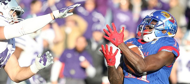 Kansas wide receiver Steven Sims Jr. (11) pulls in a deep touchdown catch during the fourth quarter on Saturday, Oct. 28, 2017 at Memorial Stadium.