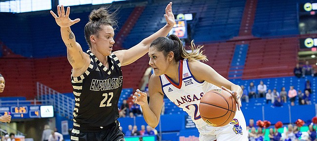 Kansas junior guard Brianna Osorio (2) tries to drive past Emporia State defender Jacee Kramer (22) in the first quarter of Sunday's exhibition game at Allen Fieldhouse.