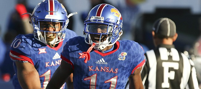 Kansas wide receiver Steven Sims Jr. (11) celebrates with Kansas running back Khalil Herbert (10) after a touchdown catch during the fourth quarter on Saturday, Oct. 28, 2017 at Memorial Stadium.