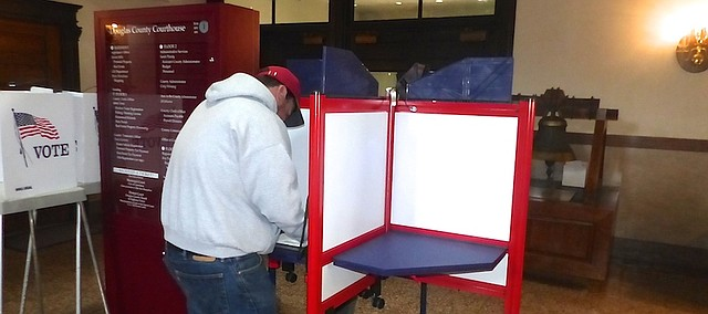 Joseph Mastrosimone, of Lawrence, casts his vote for the city/school board election Monday at the Douglas County Courthouse. Heather Dill, deputy election clerk for the Douglas County Clerk's Office, said 500 county residents have already voted at the courthouse and move than 2,000 more have returned mail-in advance voting ballots.