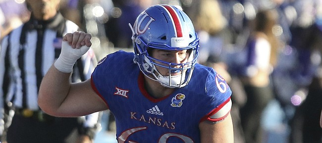 Kansas redshirt sophomore center Mesa Ribordy (69) gets set at the line during the third quarter against Kansas State on Saturday, Oct. 28, 2017 at Memorial Stadium.