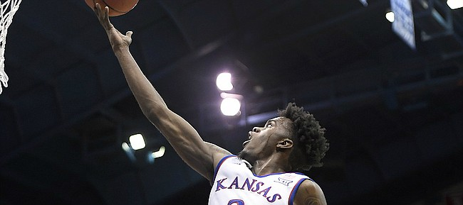 Kansas junior guard Lagerald Vick makes an acrobatic layup Tuesday in an exhibition game against Pittsburg State at Allen Fieldhouse.