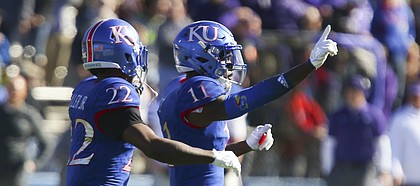 Kansas safety Mike Lee (11) celebrates with Kansas safety Tyrone Miller Jr. (22) after stopping Kansas State on a fourth and 1 during the first quarter on Saturday, Oct. 28, 2017 at Memorial Stadium.