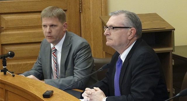 Kansas budget director Shawn Sullivan, left, and Legislative Research Department director Raney Gilliland announce that official revenue forecasts for the next year and a half have been raised by $225 million, due mainly to growth in sales taxes and corporate income taxes.