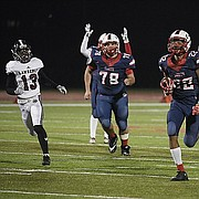 Olathe North running back Daymonn Sanchez runs for a touchdown against Lawrence High on Friday at Olathe District Activity Center.