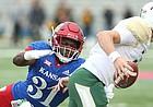 Kansas linebacker Osaze Ogbebor (31) stops Baylor Bears quarterback Zach Smith (11) on a third down during the first quarter on Saturday, Sept. 4, 2017 at Memorial Stadium.