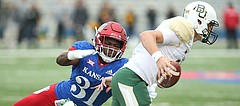 Kansas linebacker Osaze Ogbebor (31) stops Baylor Bears quarterback Zach Smith (11) on a third down during the first quarter on Saturday, Sept. 4, 2017 at Memorial Stadium.