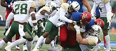 The Baylor defense drags down Kansas running back Khalil Herbert (10) during the first quarter on Saturday, Sept. 4, 2017 at Memorial Stadium.