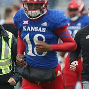 Kansas head coach David Beaty runs off the field following the Jayhawks' 38-9 loss to Baylor on Saturday, Sept. 4, 2017 at Memorial Stadium. Before Saturday's game, Baylor was winless on the season.