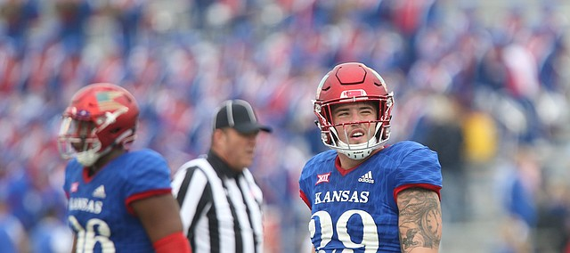 Kansas linebacker Joe Dineen Jr. (29) reacts after watching an interception replay on the video board during the third quarter on Saturday, Sept. 4, 2017 at Memorial Stadium.