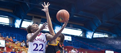 KU's Chayla Cheadle (22) takes the ball to the basket as Pittsburg State's Athena Alvarado (4) defends during the Jayhawks' exhibition victory over the Gorillas on Sunday, Nov. 5, 2017 at Allen Fieldhouse.