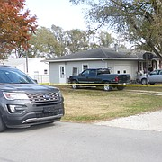 A crew works Monday, Nov. 6, 2017, on the porch of a house at 1104 East 1200 Road where the body of 34-year-old Joel Wales, of Eudora, was found Friday, Nov. 3, 2017, when firefighters and the Douglas County Sheriff's Office responded to a report of a fire and gunshots. The sheriff's office is investigating the incident as a homicide.
