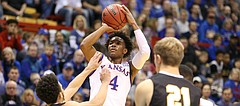 Kansas guard Devonte' Graham (4) pulls up for a three over Fort Hays State guard Aaron Nicholson (1) during the first half, Tuesday, Nov. 7, 2017 at Allen Fieldhouse.