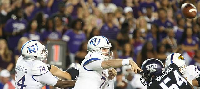 Kansas quarterback Peyton Bender (7) throws a pass during the first quarter, Saturday, Oct. 21, 2017 at Amon G. Carter Stadium in Fort Worth.