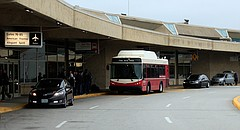 A bus picks up passengers bound for gates located in other terminals at Kansas City International Airport in Kansas City, Mo., Wednesday, Nov. 1, 2017.  (AP Photo/Orlin Wagner)