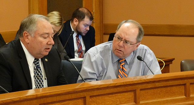 Senate Democratic Leader Anthony Hensley, of Topeka, right, questions Sen. Jim Denning, the Republican leader, about hiring an outside consultant to advise the Legislature on school finance during a meeting Tuesday of the Legislative Coordinating Council.