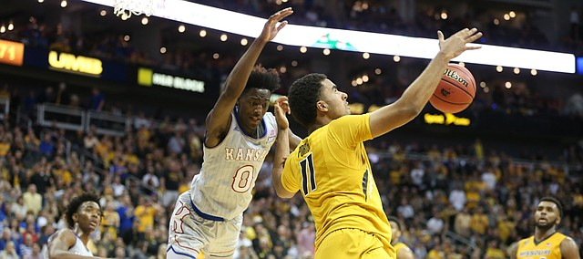 Missouri forward Jontay Porter (11) fouls Kansas guard Marcus Garrett (0) on the drive during the second half of the Showdown for Relief exhibition, Sunday, Oct. 22, 2017 at Sprint Center in Kansas City, Missouri.