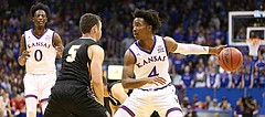 Kansas guard Devonte' Graham (4) regains his dribble while defended by Fort Hays State guard Kyler Kinnamon (5) during the first half, Tuesday, Nov. 7, 2017 at Allen Fieldhouse.