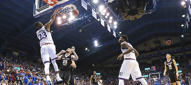 Kansas forward Billy Preston (23) delivers a dunk over Fort Hays State forward Brady Werth (25) during the second half, Tuesday, Nov. 7, 2017 at Allen Fieldhouse.