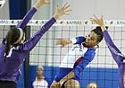 Kansas middle blocker Zoe Hill (6) sends a shot between Kansas State middle blocker Peyton Williams (11) and Kansas State middle blocker Elle Sandbothe (2) during the second set on Wednesday, Nov. 8, 2017.