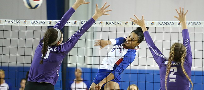 Kansas middle blocker Zoe Hill (6) sends a shot between Kansas State middle blocker Peyton Williams (11) and Kansas State middle blocker Elle Sandbothe (2) during the second set on Wednesday, Nov. 8, 2017.