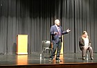 Jay Pryor speaks to an audience of students, parents, staff and community members Wednesday night at Lawrence High School while Stephanie Mott, seated, watches on. Pryor, of Lawrence, and Mott, of Topeka, visited the school Wednesday to share their experiences growing up transgender in an effort to raise awareness of LGBTQ-plus issues facing those in the Lawrence community.