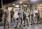 Members of the Kansas Army National Guard's 242nd Engineer Company depart Kansas City International Airport Tuesday, Nov. 7, as they travel to Puerto Rico to help repair damage from Hurricane Maria.