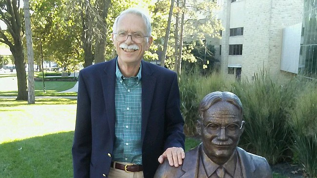 Jim Naismith, 81, of Corpus Christi, Texas, stands with a statue of his grandfather, Dr. James Naismith, outside of the DeBruce Center near Allen Fieldhouse during a recent visit to Lawrence. Although his grandfather passed away when he was just 3 years old, Jim Naismith has spent much of his life learning as much as possible about the man who invented the game of basketball in the late 1800s.