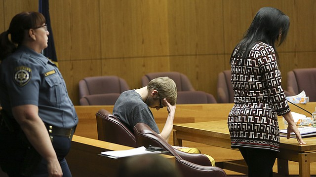 James Fletcher rests his head in his hand as Judge Peggy Kittel reviews his sentence in Douglas County District Court on Thursday, Nov. 9, 2017.
