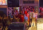 "In this file photo from August 2014, patrons line up to enter the Jayhawk Cafe, more commonly known as ""The Hawk,"" at 1340 Ohio St."