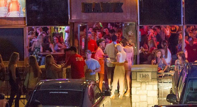 """In this file photo from August 2014, patrons line up to enter the Jayhawk Cafe, more commonly known as """"The Hawk,"""" at 1340 Ohio St."""