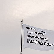 """Yoko Ono's """"IMAGINE PEACE"""" flag, pictured here, is the sixth of 16 flags commissioned by the New York-based nonprofit Creative Time for a nationwide public art project meant to""""inspire a sense of community among cultural institutions. The University of Kansas is one of 11 institutions nationwide to participate in the project, """"Pledges of Allegiances."""" Ono's flag was raised earlier this week near Spooner Hall on the KU campus."""