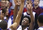 Kansas guard Marcus Garrett (0) defends against a shot from Tennessee State guard Darreon Reddick (14) during the first half on Friday, Nov. 10, 2017 at Allen Fieldhouse.