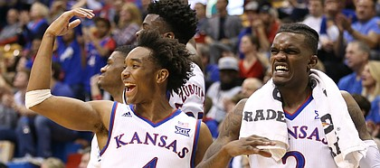 Kansas guard Devonte' Graham (4), Kansas guard Lagerald Vick (2) and the Kansas bench celebrate a bucket from Clay Young during the second half on Friday, Nov. 10, 2017 at Allen Fieldhouse.