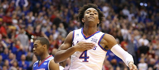 Kansas guard Devonte' Graham (4) pounds his chest after a steal and a dunk during the first half on Friday, Nov. 10, 2017 at Allen Fieldhouse.