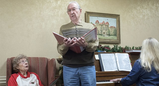 Retired KU journalism professor Bruce Linton sings a song to his wife, Chris Linton, left, during a meeting of the Endacott Society Friday, Nov. 10, 2017. Linton wrote music to a poem he came across in June of 1945, when he was serving in France in WWII. The sentiments of the poem, written by an anonymous author, spoke to Linton and his feelings for Chris. At left is Endacott member and accompanist Linda Mannering.