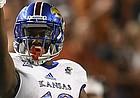Kansas wide receiver Evan Fairs (19) celebrates a completion during first half of an NCAA football game, Saturday, Nov. 11, 2017 in Austin, Texas. (TFV Media via AP)