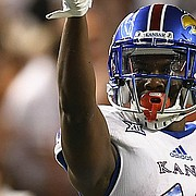 Kansas wide receiver Evan Fairs (19) celebrates a completion during first half of an NCAA football game, Saturday, Nov. 11, 2017 in Austin, Texas. (TFV Media via AP)
